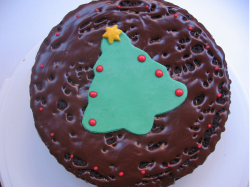 Image of chocolate holiday cake with christmas tree in the center.PNG