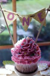 First Birthday Pink Birthday Cupcake with Triangle Flags Spelling Out ONE.JPG