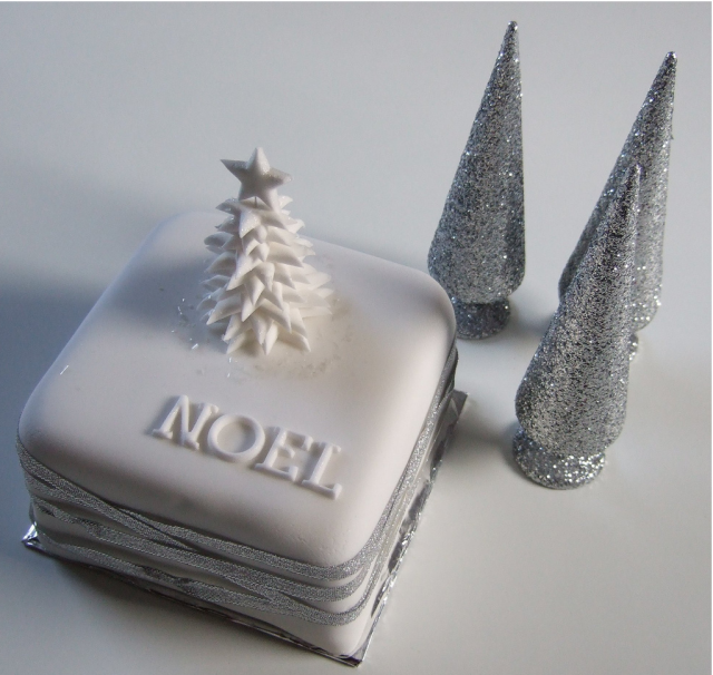 Noel cakes picture in white and silver looking so elegant.PNG