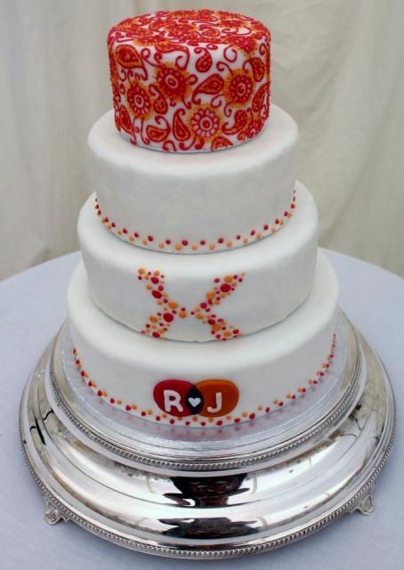 White 4 Tier Wedding Cake With Red And Orange Floral Accents Plus Monogram On First Level Jpg Hi Res 720p Hd