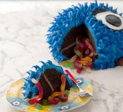 Monster pinata cake filled with worm gummies.JPG