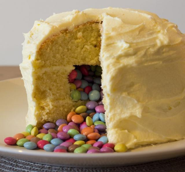 Small homemade pinata cake with vanilla flavor filled with M & M.JPG
