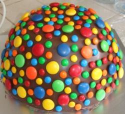 Colorful pinata cakes with chocolate cover and decorated with M & Ms.JPG