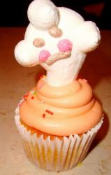 Pumpkin cupcake with ghost marshmallow.JPG