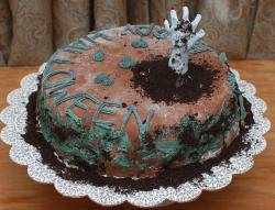 Scary halloween cake with hand sticking out from the grave yard.JPG
