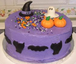Witch cake perfect for Halloween with pumpkin, ghost and witch hat.JPG