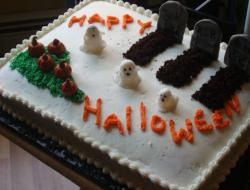 2015 Halloween cake with grave yard theme with ghosts.JPG