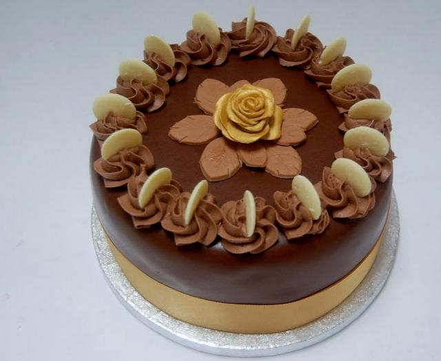Round Chocolate Cake with White Chocolate Cookies and Golden Rose.JPG ...