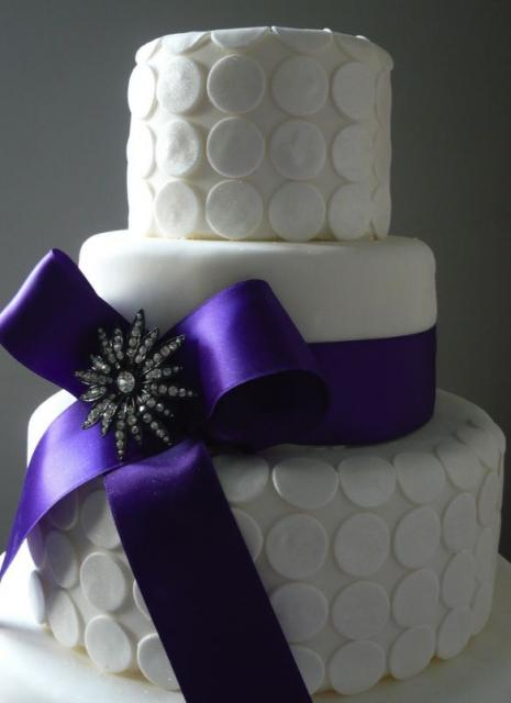 Three Tier White Wedding Cake With White Coins And Large