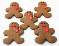 Valentines' day gingerbread man cookies with hearts.PNG