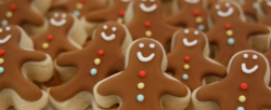 Chocolate gingerbread man cookies with cute dercor.PNG