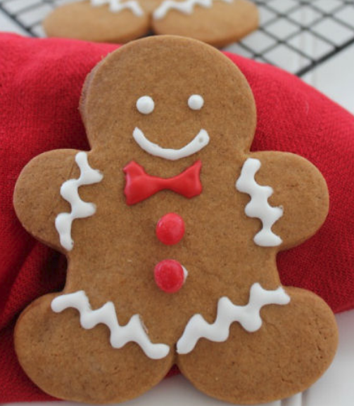 Fun gingerbread man cookies with red bow.PNG