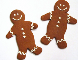 Gingerbread man cookies with cake decor with white frosting.PNG