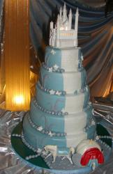 Five tier white castle cake in teal and white.JPG