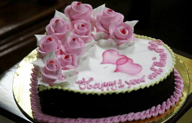 Heart-Shaped First Anniversary Cake with Pink Pastry Roses.JPG