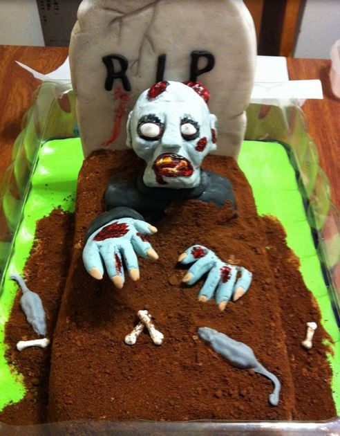 Zombie cake with zombie coming out from the grave.JPG