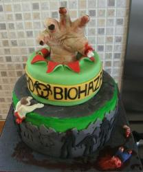 Zombie Cake with zombie hand stick up.JPG