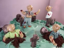 Zombie birthday cake with full of cute fondant zombies.JPG