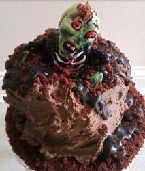 Zombie Birthday Cake with zombie coming out from the garveyard.JPG