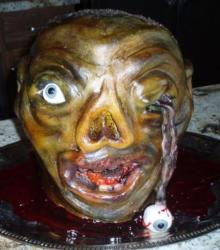 Scary looking zombie cake with eye pupping out.JPG