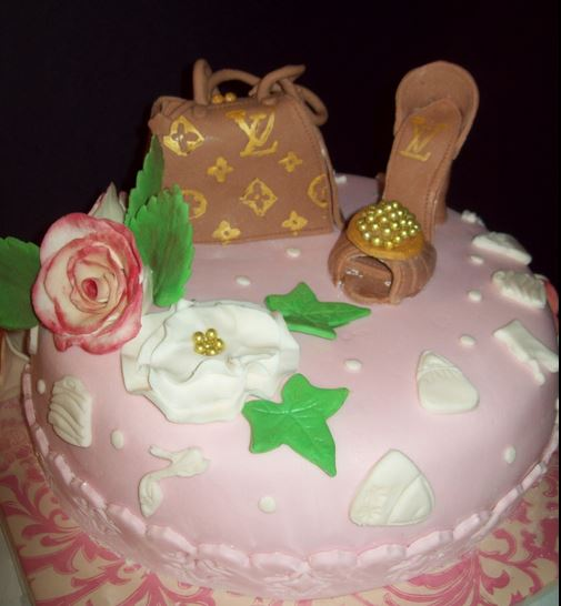 Pink LV cake with Louis Vuitton cake toppers.JPG