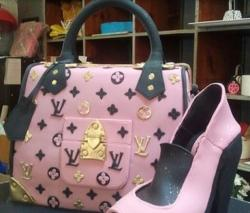 Black and pink Louis Vuitton purse cake picture.JPG