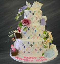 Large Multi colors Louis Vuitton birthday cake with cake toppers theme with fashion purses and shoes.JPG