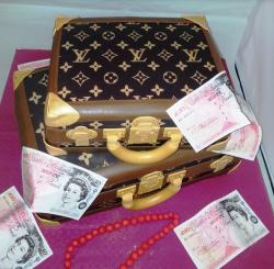 Louis Vuitton suitecases with Pounds and jewelry cake photo.JPG