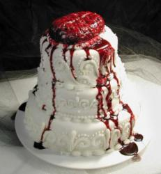 Bloody looking halloween wedding cake with bleeding brain cake topper.JPG