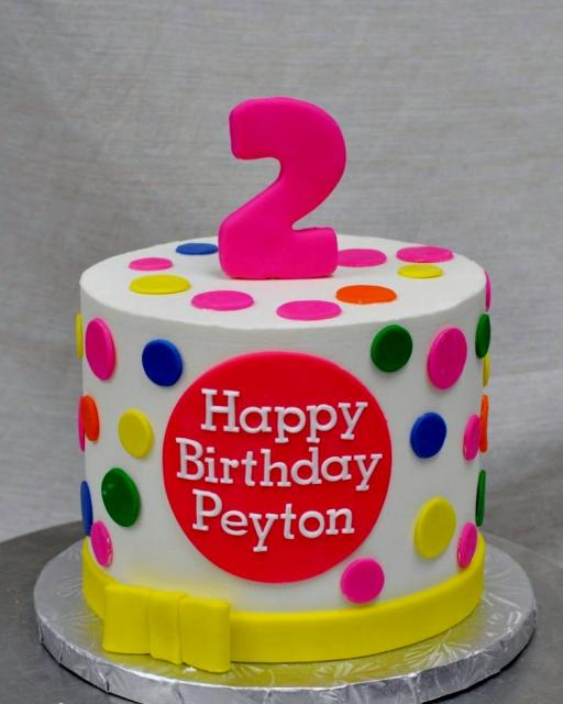 Cute Personalized Pokadot Second Birthday Cake With Yellow Bow For