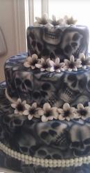 Skull cakes in three tiers with skull prints and flowers.JPG
