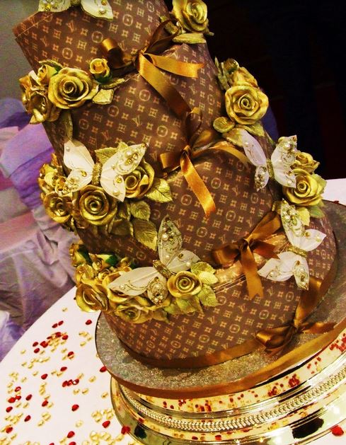 Louis Vuitton wedding cake with gold cake flowers.JPG