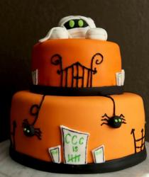 Large orange halloween cake with mummy cake toppers and spiders cake decor.JPG