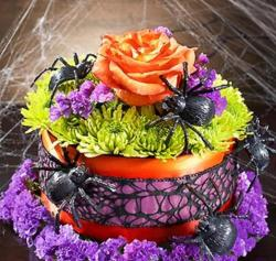 Pretty halloween cake with fresh flowers and big spiders cake decor.JPG