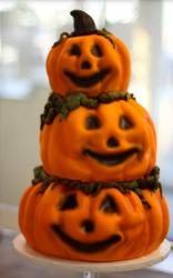 Three tiers pumpkin cakes in orange.JPG