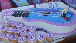 Guitar shaped birthday cakes with cupcakes.JPG