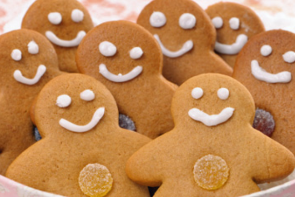 Holiday cookies picture of gingerbread men with smily.PNG