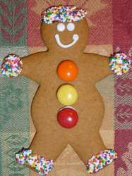 Large gingerbread man cookie with colorful candy cookie decor.PNG