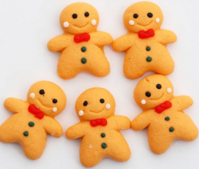 Tiny gingerbread men cookies with red bows.PNG