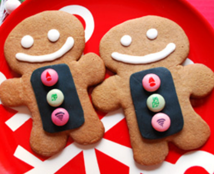 2015 gingerbread men cookies with candy decor.PNG