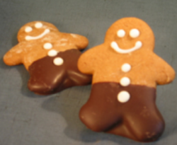 Chocolate Gingerbread men cookie with frosting cookie decoration.PNG