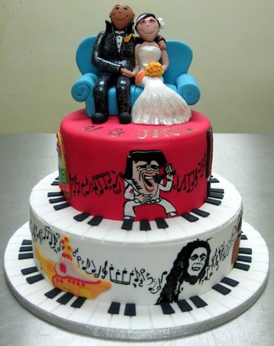 Theme Two Tier Wedding Cake With Bride And Groom Toppers Sitting