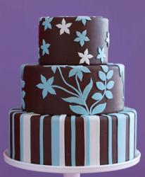 Chocolate wedding with white and blue cake decor.jpg