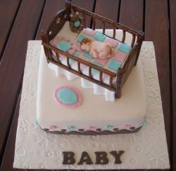 Baby Shower cake with baby in crib.JPG