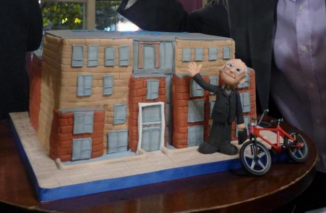 Retirement Cake with Realistic Depiction of Retiree next to Company Building and Bike.JPG