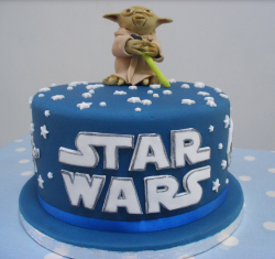 Blue star wars cake with yoda holder a lightsaber.PNG
