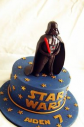 Darth Vader kids birthday cake in blue with cool Darth Vader cake topper holding red lightsaber.PNG