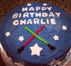 Homemade Star War cakes with lightsabers cake decor.PNG