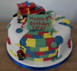 Kids professional birthday lego cake with lego figure and lego fire truck.JPG