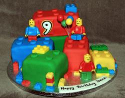 Large kids birthday cake with lego figures and lego balloons.JPG